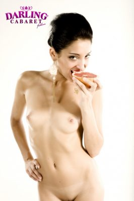 Naked brunette hot girl eating the orange at the best strip bar in Prague