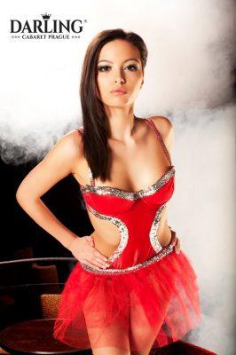 Hot Czech girl with big tits and drown hair in red dress is on the stage at Darling cabaret in Prague.