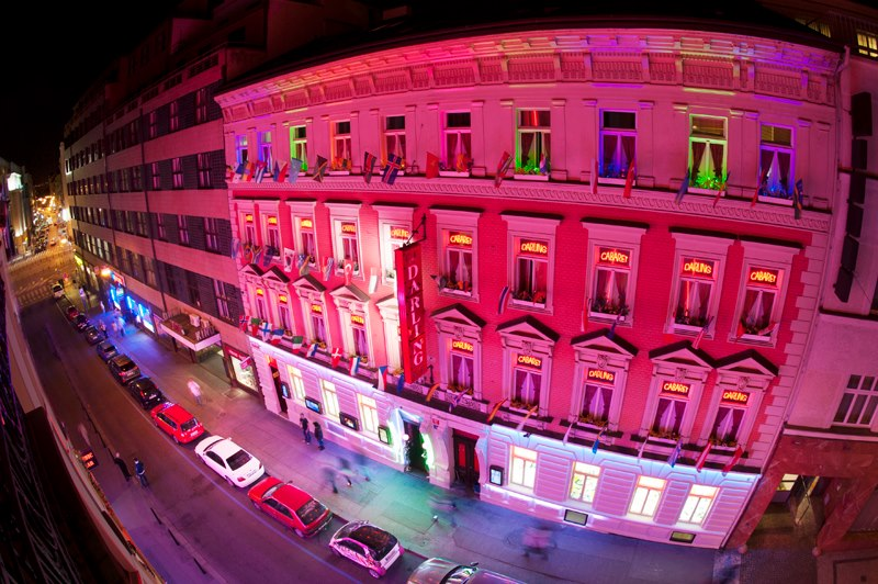 Strip club in Prague Darling cabaret building at night from view of bulding in front of