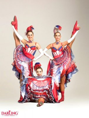 Three hot dancers in sexy can-can dresses have a fun from Darling cabaret in Prague showing their naked legs