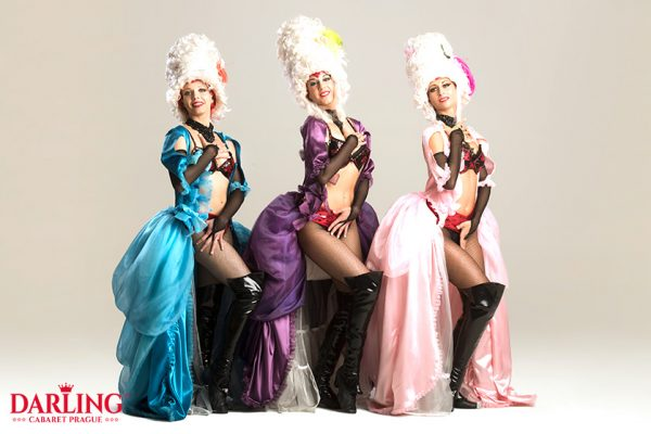 Three hot girls in baroque dresses and corsets show their sexy bodies at Darling Cabaret in Prague